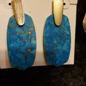 Kendra Scott turquoise earrings.
